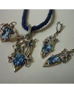 Естравагантен авторски комплект сребърни бижута със син корунд