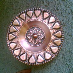 Декоративна чиния, кована мед, Успех